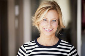 Smiling blond woman in striped shirt