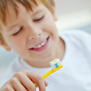 kid holding a toothbrush