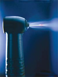 A closeup view of a dental laser emitting light.
