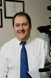 Photo - Dr. Douglas E. Lewis, MD