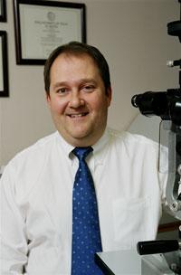 Photo - Dr. Douglas E. Lewis, MD