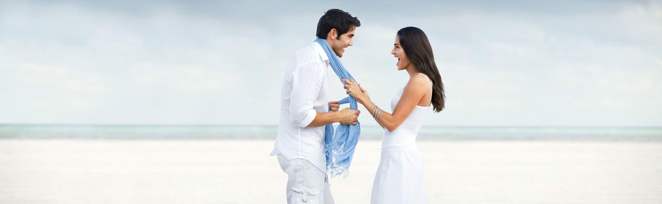 Happy couple in white on beach